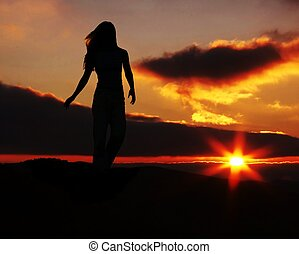 Girl silhouette on sunset