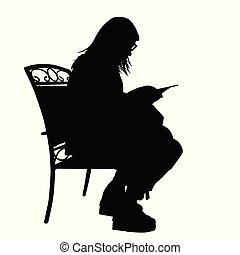 Girl silhouette reading a book