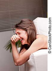girl sincerely laughing out loud