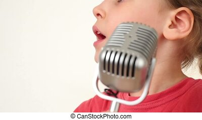 Girl sing song in microphone