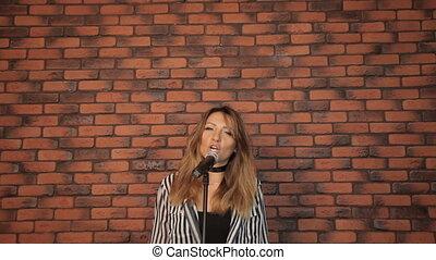 Girl singer singing in a studio