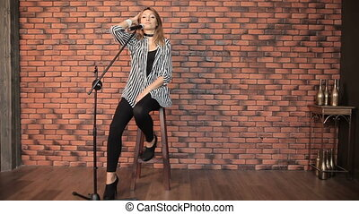 Girl singer singing in a studio