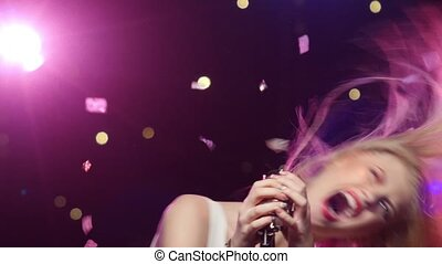 Girl singing dancing with retro microphone. Dynamic change of focus