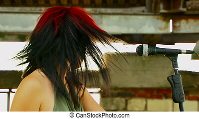Girl sings a song - Beautiful girl with multicolored hair,...