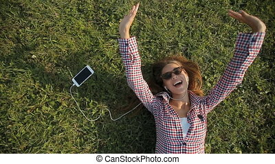 Girl Sings Happily on Grass - Happy slender girl in...