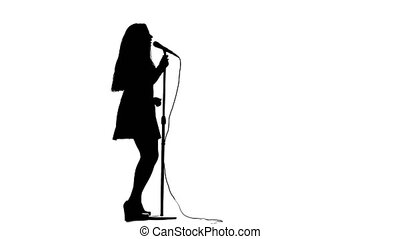 Girl sings in a retro rock song microphone. White...