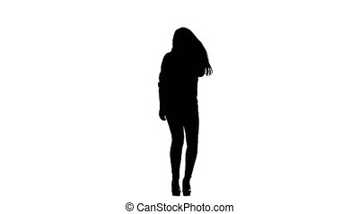 Girl sings incendiary songs into the microphone. White background. Silhouette. Slow motion