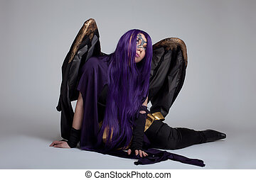 girl in purple witch cosplay costume anime character sit portrait