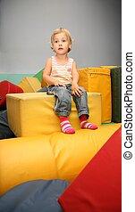 girl sit on yellow cube