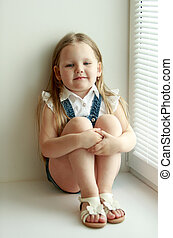 girl sits at the window