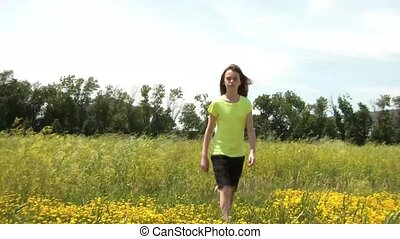 Girl Sits Down in Yellow Flower Field - Girl walks slowly...