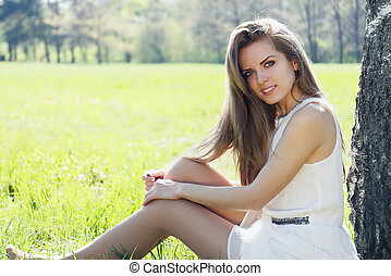 girl sits in the meadow