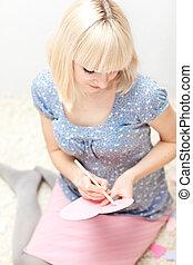 Girl sitting and writting something