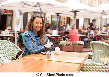 girl sitting at a cafeteria