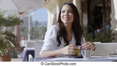 Girl Sitting At Cafe With Cup Of Tea