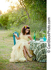 girl sitting at table looking