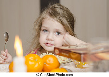 girl sitting at the holiday table