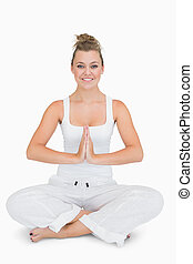 Girl sitting cross-legged in yoga pose