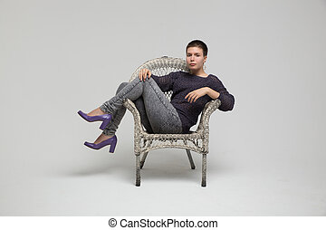 Girl sitting in chair, isolated
