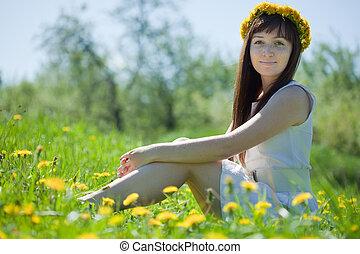 girl sitting in dandelion wreath