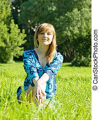 girl sitting in meadow grass