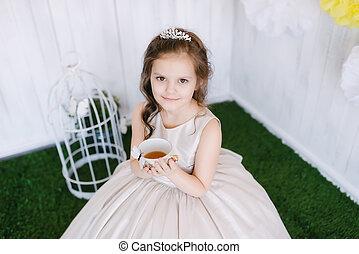 girl sitting in the studio drinking tea