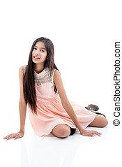 girl sitting isolated on white background