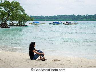Girl Sitting on a Beach alone