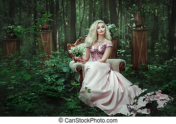 Girl sitting on a chair in the forest. - Girl in evening...