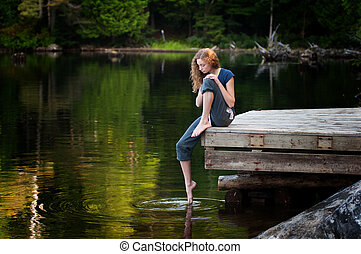 girl sitting on a dock