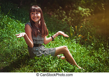 Girl sitting on a grass