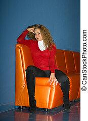 girl sitting on a sofa 2