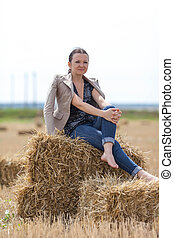 girl sitting on a stack