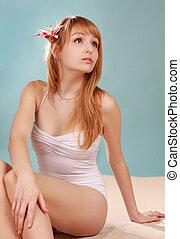 girl sitting on fake beach
