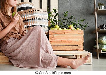 Girl sitting on pallet