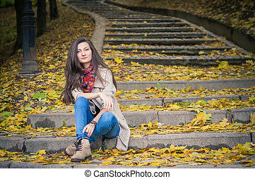 girl sitting on stone steps