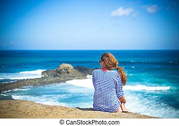 Girl Sitting on the Beach