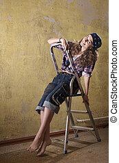 girl sitting on the ladder