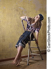 girl sitting on the ladder