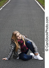 girl sitting on the road