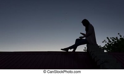 girl sitting on the roof
