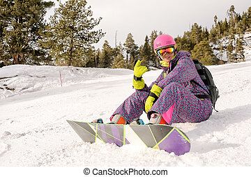 girl sitting on the ski slopes