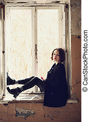 girl sitting on the window