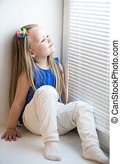 Girl sitting on the windowsill