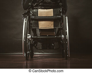 Girl sitting on wheelchair.
