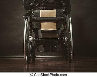 Girl sitting on wheelchair.