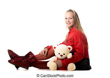 Girl sitting with stuffed animal