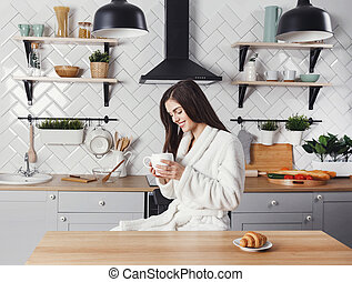 Girl Sitting with the Cup of Coffee