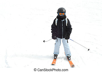 Young girl skiing downhill