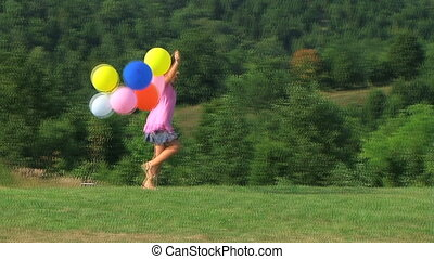 Girl Skipping with Balloons - Little girl skipping with...